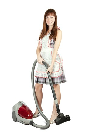 Girl in with vacuum cleaner. Isolated over white background photo