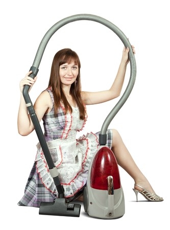 Girl in with vacuum cleaner. Isolated over white background Stock Photo - 7148240