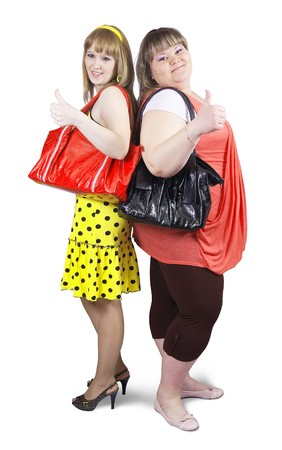 meagre: Two happy casual girls with handbag over white background