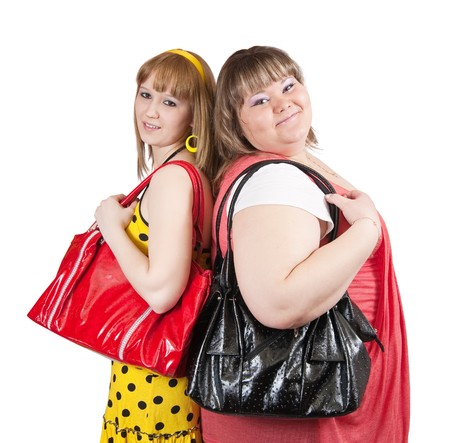meagre: Two casual girls with handbags over white background Stock Photo