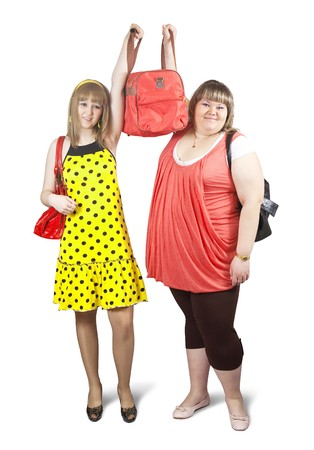 Two happy casual girls with travelling bag over white background Banco de Imagens