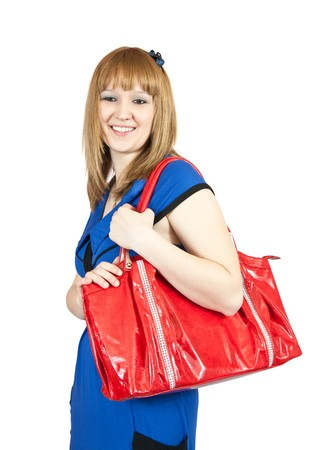 young woman with handbag standing on a white background