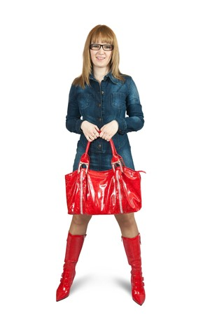 Girl in blue dress and red high boots with purse. Isolated over white