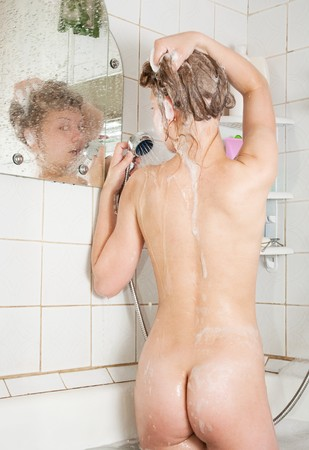 nude woman standing: young beauty girl standing near mirror in bath