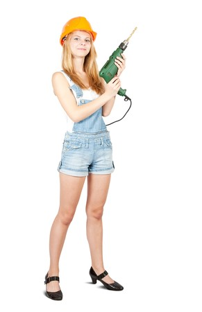 beauty girl in hard hat with drill over white photo