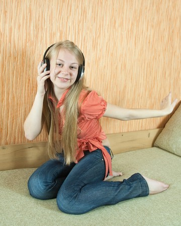 househould: young girl listen to the music with head phones Stock Photo