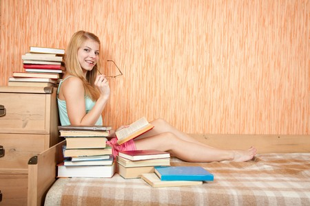A young woman studying hard on sofa at home photo