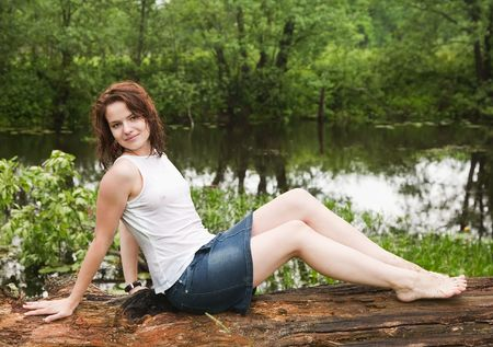 wet jeans:  girl in wet shirt on old tree during rain