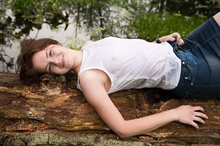 wet jeans:  Sexy girl in white wet shirt on old tree