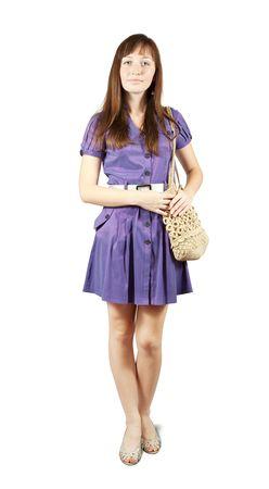 young girl with handbag standing on white background Banco de Imagens