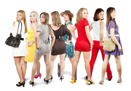 Rear view of group Stylish girls. Isolated over white photo