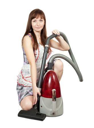 Girl in with vacuum cleaner. Isolated over white background Stock Photo - 7173152