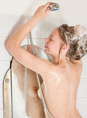 Long-haired girl shampooes with foam in bath Stock Photo - 7243317