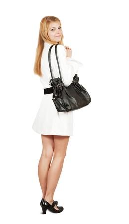 Pretty  girl in cloak with purse. Isolated over white Banco de Imagens