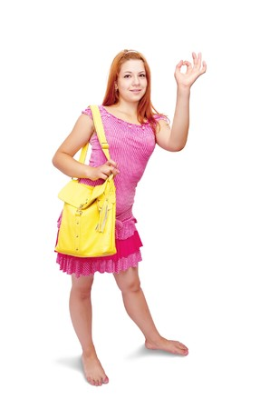 yellow dress: red-haired girl in pink dress with OK over white