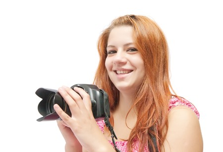 carroty: Young girl with camera isolated over white