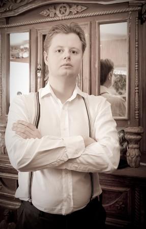 Retro portrait of man against vintage furniture photo