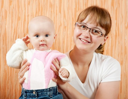 mother with her little daughter in home interior photo