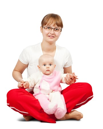 sitting happy mother with her daughter. Isolated over white photo