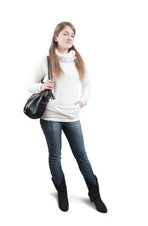 Isolated full length view of Long-haired teen girl in sweater with bag over white photo