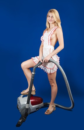 sexy maid: Girl  with vacuum cleaner over blue background
