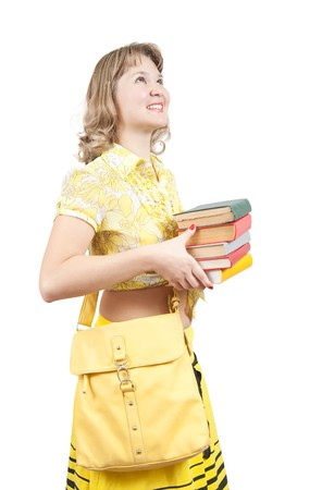 Female student dressed in yellow with books and bag, isolated over white