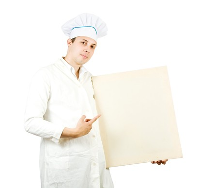 cook man in toque pointing at blank canvas, over white background photo
