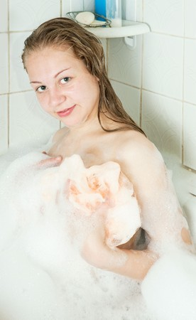 Young girl relaxing with foam in bath Stock Photo - 7295224
