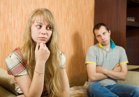Young sad woman and man at home, selective focus Stock Photo - 7314133