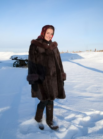 girl in russian traditional clothes against  winter rural landscape Stock Photo - 7334905
