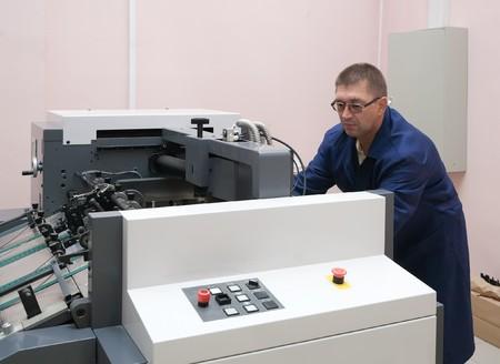 Printer working at his new offset machine Stock Photo - 7366620