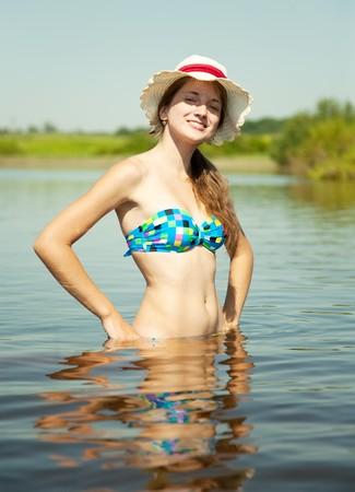 Portrait of teenage girl wearing straw hat  photo