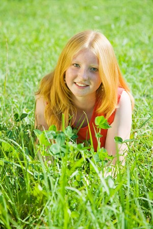 Carroty  teenager girl lying at meadow grass Stock Photo - 7375237