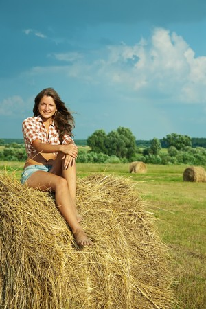 country girl on fresh straw at field Stock Photo - 7375306