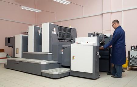 Printer working at his modern offset machine Stock Photo - 7394585