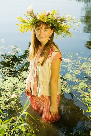 seamaid: girl  in russian traditional clothes in river