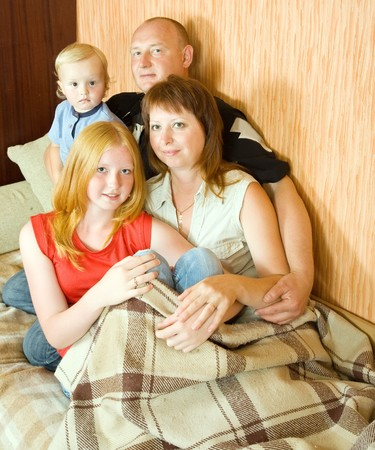 Portrait of happy family relaxing together on sofa Stock Photo - 7420433
