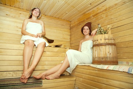 Young women is taking steam-bath  at sauna  photo