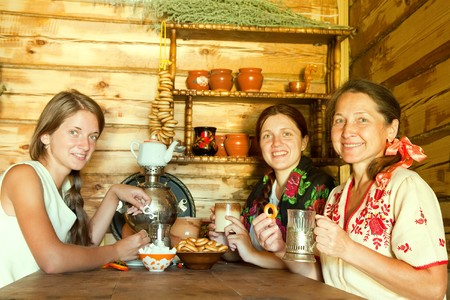 washhouse: three women having tea in russian traditional interior