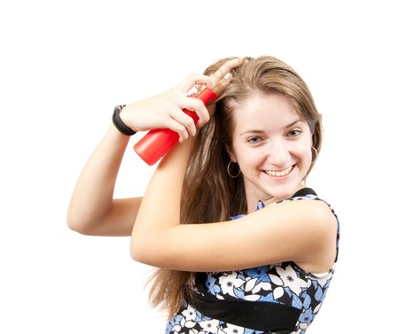 Womans portrait with deodorant spray on her hair  photo