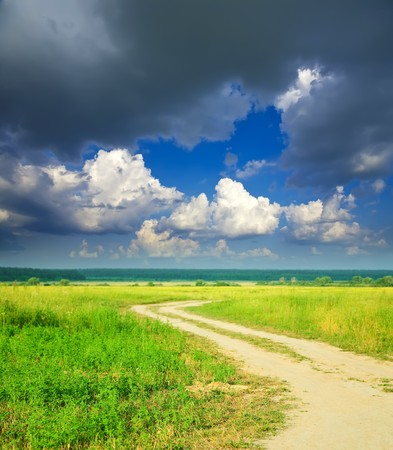 Summer landscape with road and cloudy sky photo