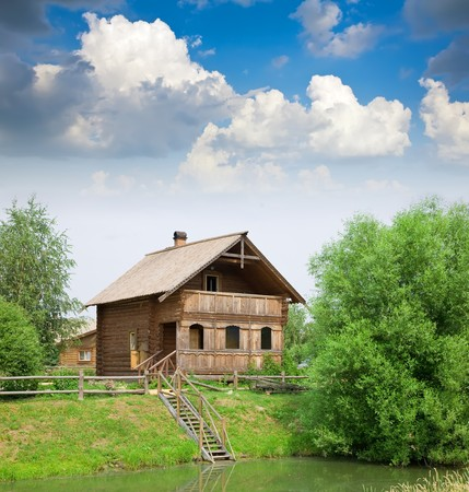 Wooden country house on the lake in summer photo