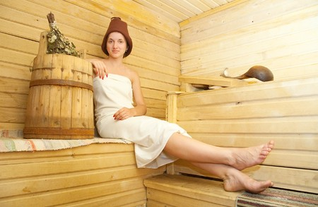 stive: Young woman taking steam bath at sauna Stock Photo