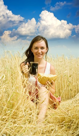 Girl  with quass and bread  at wheat field Stock Photo - 7484340