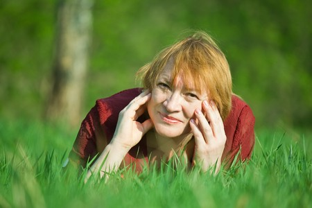 Smiling senior woman  in a spring  meadow photo