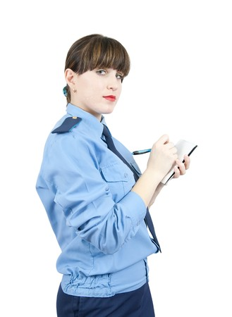 woman in uniform  writing on her notepad over white photo