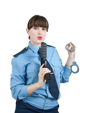 woman in uniform with gun and manacles over white photo