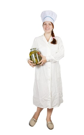 teary: Young cook girl  holding  tin of pickled  cucumbers.  isolated over white
