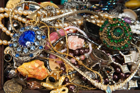 Background of closeup of Treasure chest with valuables and gem photo