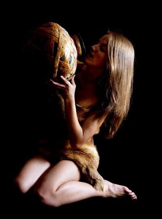 neanderthal women: Female barbarian in foxcase with jug at dark